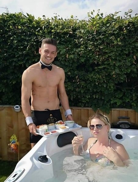 Butlers in the buff hot tub party