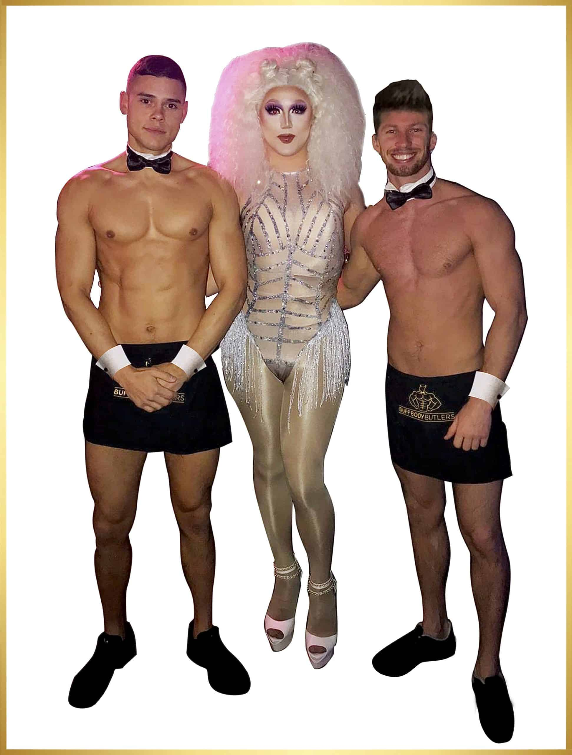 Butlers in the buff with drag queen